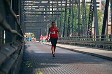 Photo of runner on bridge
