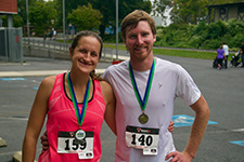 Photo of 2 participants with medals