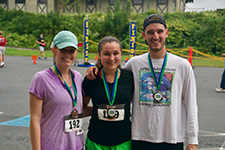 Photo of 3 participants with medals