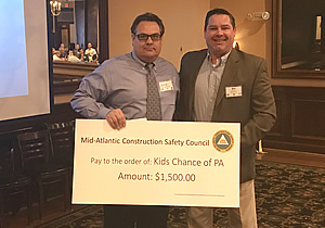 Mid-Atlantic Construction safety council members holding their donation check for $1500.