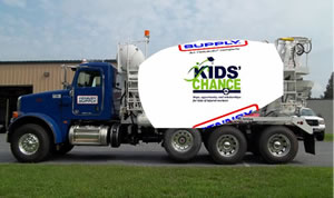 A cement truck branded with the Kids' Chance logo.