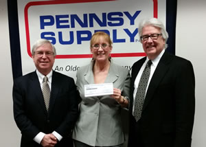 Pennsy Supply holding their donation check.